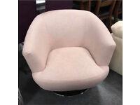 Pink fabric tub swivel chair