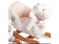 Brand New Beautiful Pink lamb rocker with matching pupet. Plays nursery rhyme.