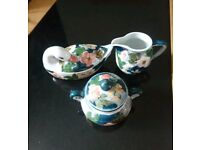Floral jug,sugar pot and duck butter dish