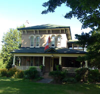 Stately property with 2 storey brick Victorian home on .98 acre.