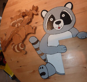 2 Wooden racoon decor pieces
