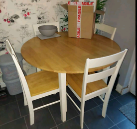 Round table and 4 chairs. Good condition. Delivery available extra c