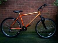 "Raleigh mountain bike,26""wheels,18 speed,front suspension"