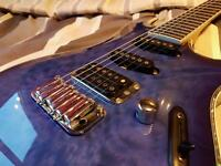 Ibanez SA360QM in trans-lavender burst and Squire Showmaster in blue