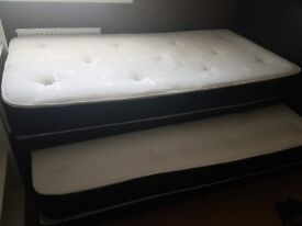 Single bed with trundle bed underneath