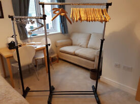 2 dual level hanging rails on castors. Can be used in multiple ways to hang lots of clothes