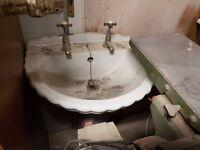 White sculptured sink with pedestal
