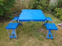 All in one blue folding table and bench