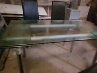 Glass Table with 6 black leather seats
