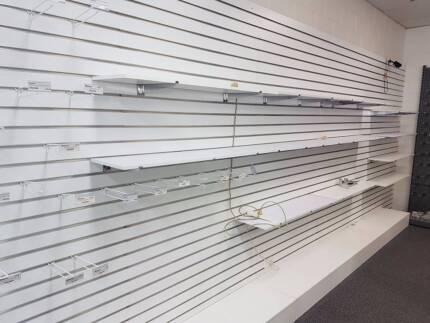 Slatwall Retail Shop Display Shelving.  $100 per panel.