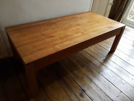 Low wooden table with drawers