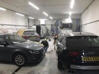 Panel beater in busy body shop repair.Friendly and professional staff