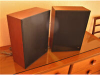 A pair of Bang & Ollufson speakers .