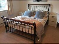 Wrought iron and wood double bed frame