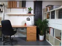 Large desk space available in creative, friendly studio.