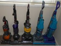 Various refurbished Dyson vacuum cleaners.