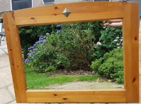 Pine mirror with pewter detail. Approximate dimensions 115 cm by 90 cm.q1q1