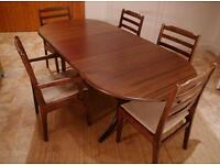 Lovely dark solid wood table with 5 chairs