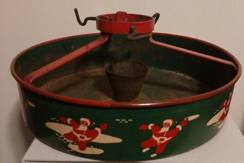Vintage Metal Christmas Tree Stand with Santas dancing around red green display