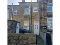 A three bedroom through-by-light mid terrace property