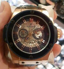 Hublot Geneve watch with leather strap