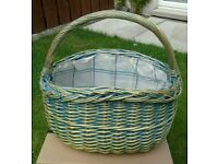 Blue and cream lined Wicker basket with handle.