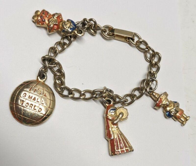 Vintage Disneyland It's A Small World Charm Bracelet. 4 Charms. Goldtone. 1964