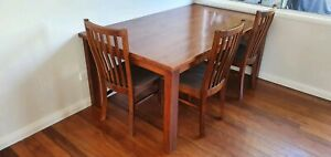 Solid timber table with 6 chairs
