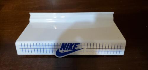 White Nike slatwall shoe shelf with blue lettering lot of 6