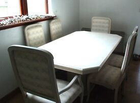 Large dining room table with 6 chairs.