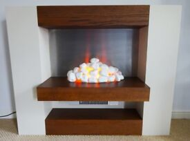 Modern freestanding electric fire suite. Cream/wood with ceramic stones/pebbles