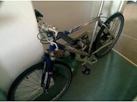 Saracen mountain bike, new pedals, bottom bracket and semi slicks
