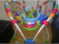 Baby Einstein jumperoo. Bouncer with 6 extra toys .