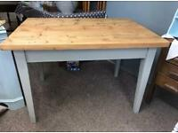 Solid rustic waxed pine top table with grey legs