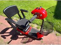 Red Motability Scooter with basket, mains-chargeable