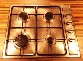 Four burner gas hob, electric oven and island chimney extractor.