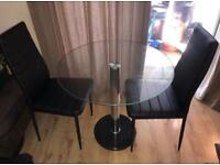 Glass top marble base table and 2 black leather chairs