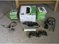 Boxed xbox 360 with games, kinect, two headphones, two wireless controllers and more.