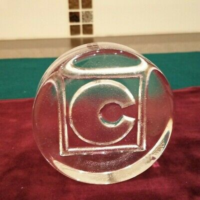 CHUBB GLASS PAPERWEIGHT. 80MM DIA. 25MM THICK. 400G WEIGHT
