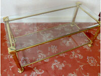 Gilded metal and bevel-edged glass coffee table in good condition.
