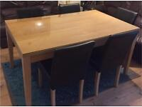 Dining table and 5 leather chairs with glass top for sale in great condition delivery available