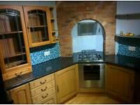 Oak kitchen, sink and dishwasher
