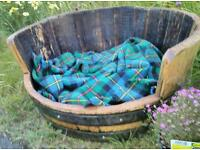 Dog bed made from recycled whisky barrels
