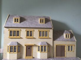 Beautiful dolls house with extension for project or play