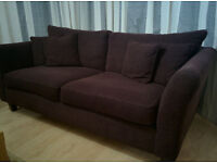 3-Seat brown sofa with 4 pilows of the same color/fabric