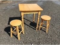 Wooden kitchen table and two stools