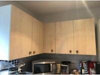 Three kitchen wall cupboards