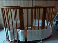 Stokke round cot bed extendable