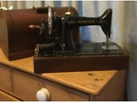 Old singer sewing machine with cover