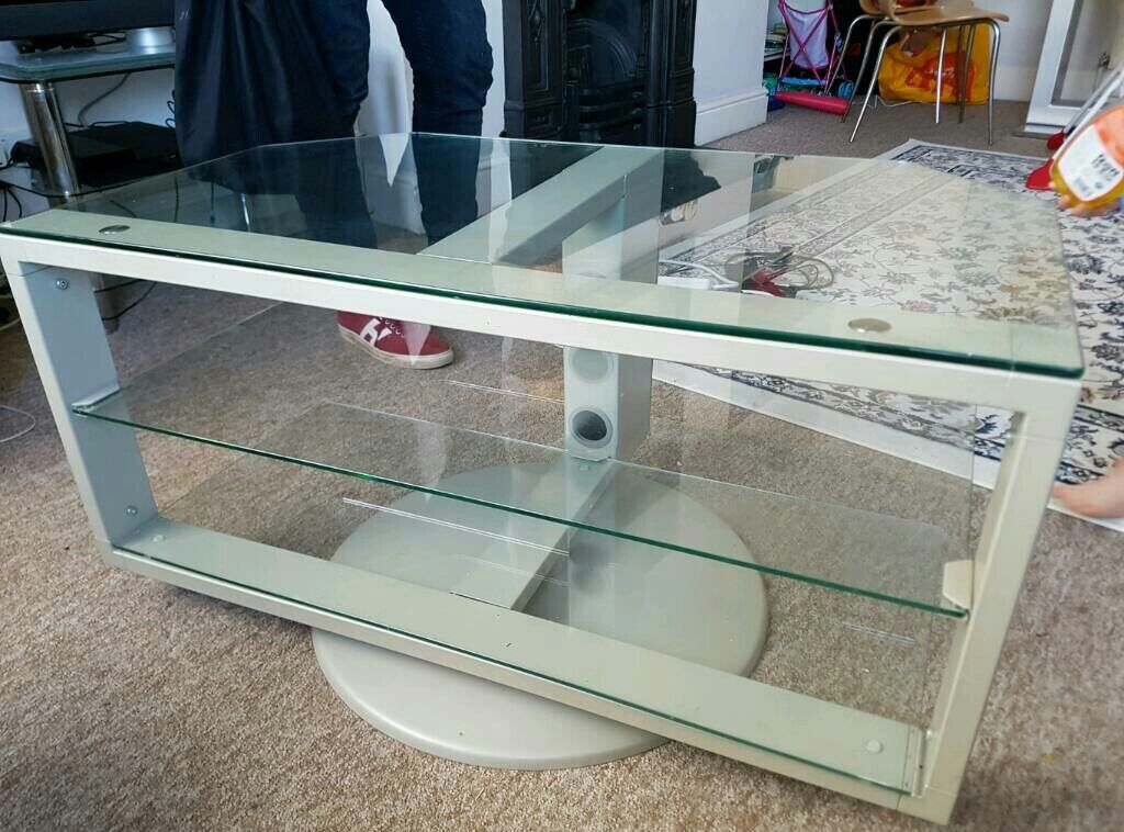 TV Stand Glassin Brighton, East SussexGumtree - Glass TV Stand. 3 shelves and cord compartment to hide the mess. Also the whole thing can swivel on it circular base.No scratches on glass and looks good. Very sturdy. Length 94cm Width 55cmHeight 48cm
